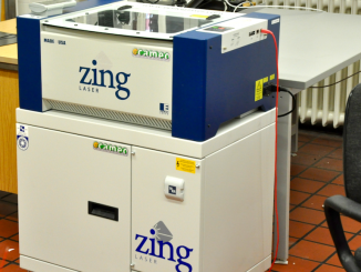 "The ""Zing"" laser engraver, with the filtration unit underneath."